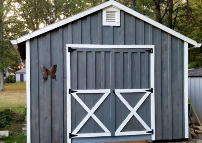 Painted Amish Shed w/eavestroughs